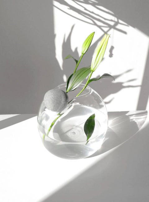 Glass vase with stone